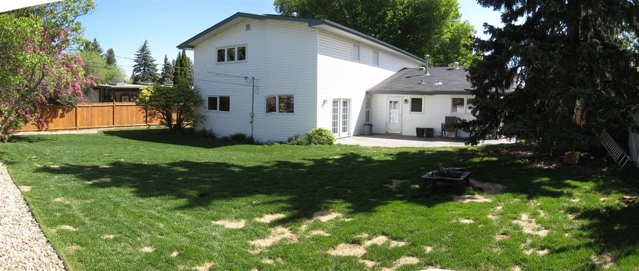 Wide view of large 79 ft wide back yard