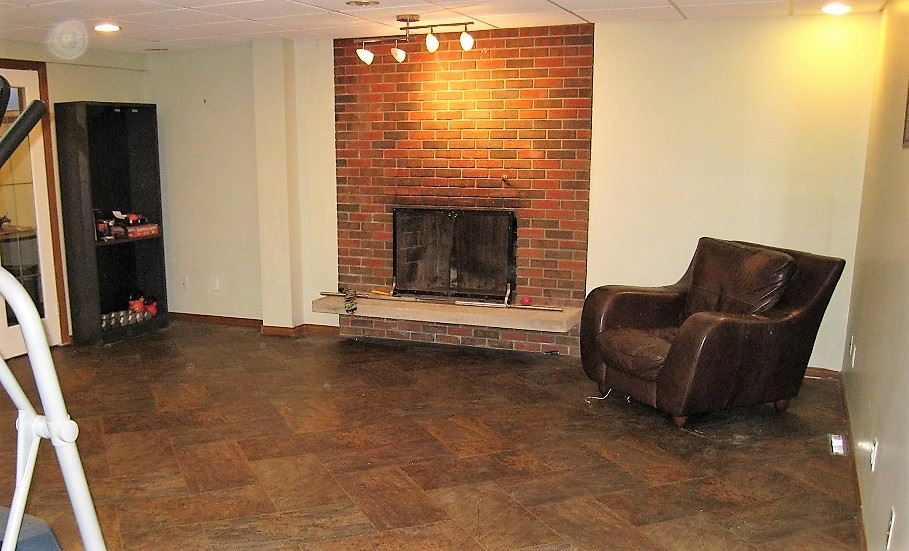 Games room (Bsmt) showing fireplace