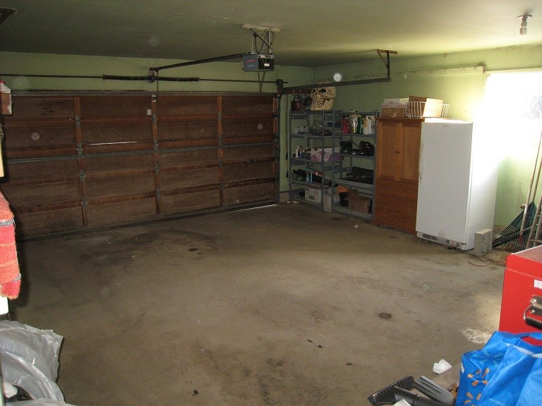 Large double attached garage with direct access to house and a man door with Dog hatch to back yard.