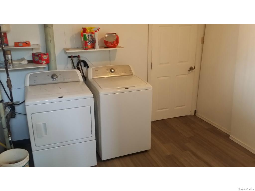 Shared laundry, separate from suite and main level.