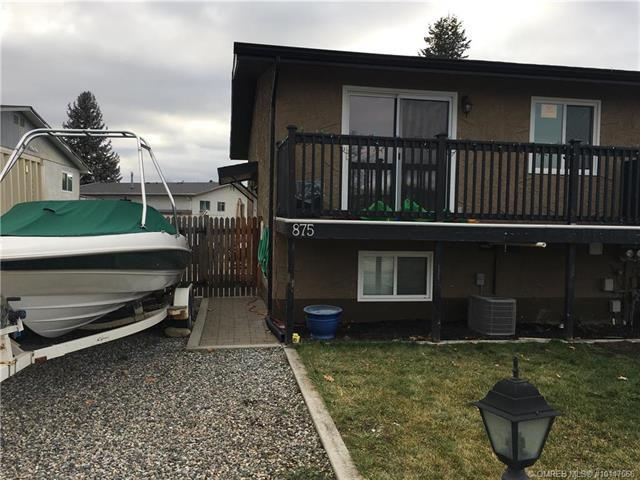 Main Photo: 875 Tataryn Road, in Kelowna: Rutland South House for sale : MLS®# 10147566