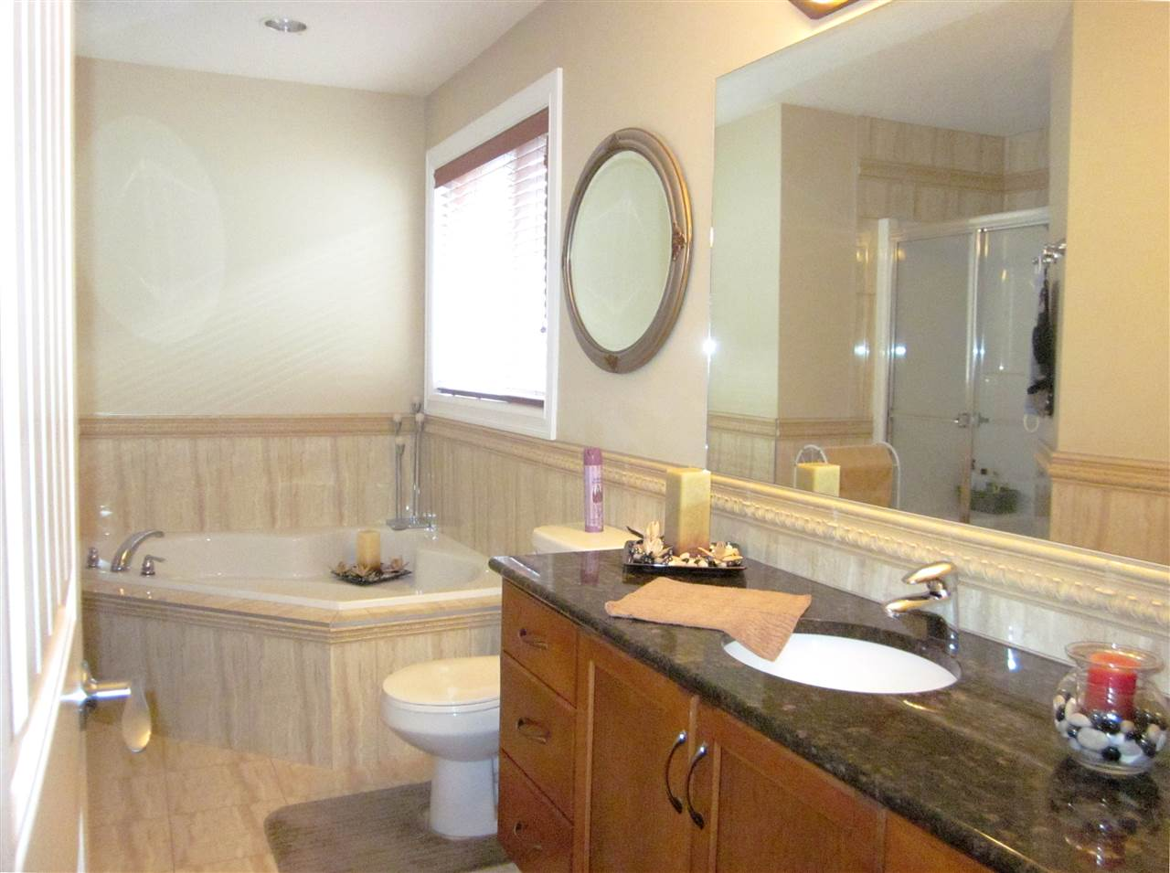 Lovely 4 pcs. master ensuite has granite vanity top, jetted tub, and separate shower.