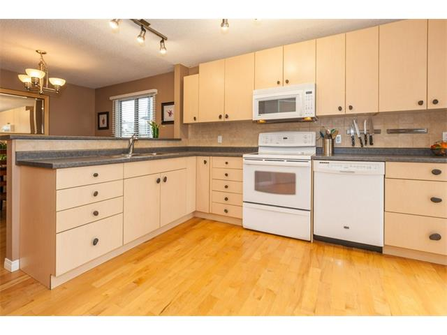Upgraded kitchen with hardwood floors and newer cabinets