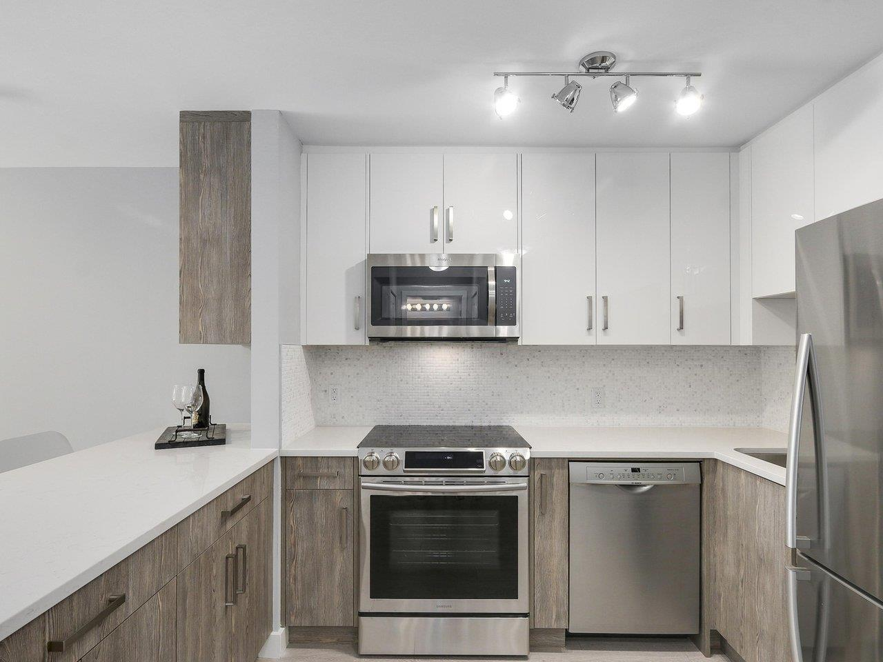 "Photo 4: 102 3624 FRASER Street in Vancouver: Fraser VE Condo for sale in ""THE TRAFALGAR"" (Vancouver East)  : MLS® # R2173895"