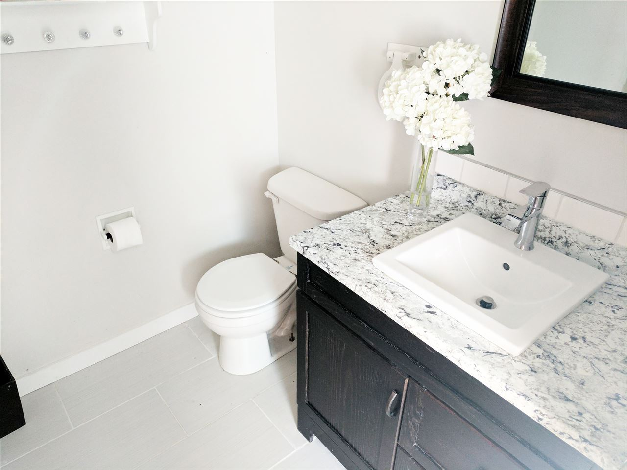 The master bath vanity, fixtures and flooring is all new!