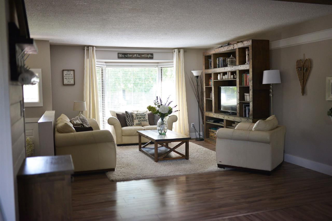 The spacious living room boasts a bow window that overlooks the mature neighbourhood.