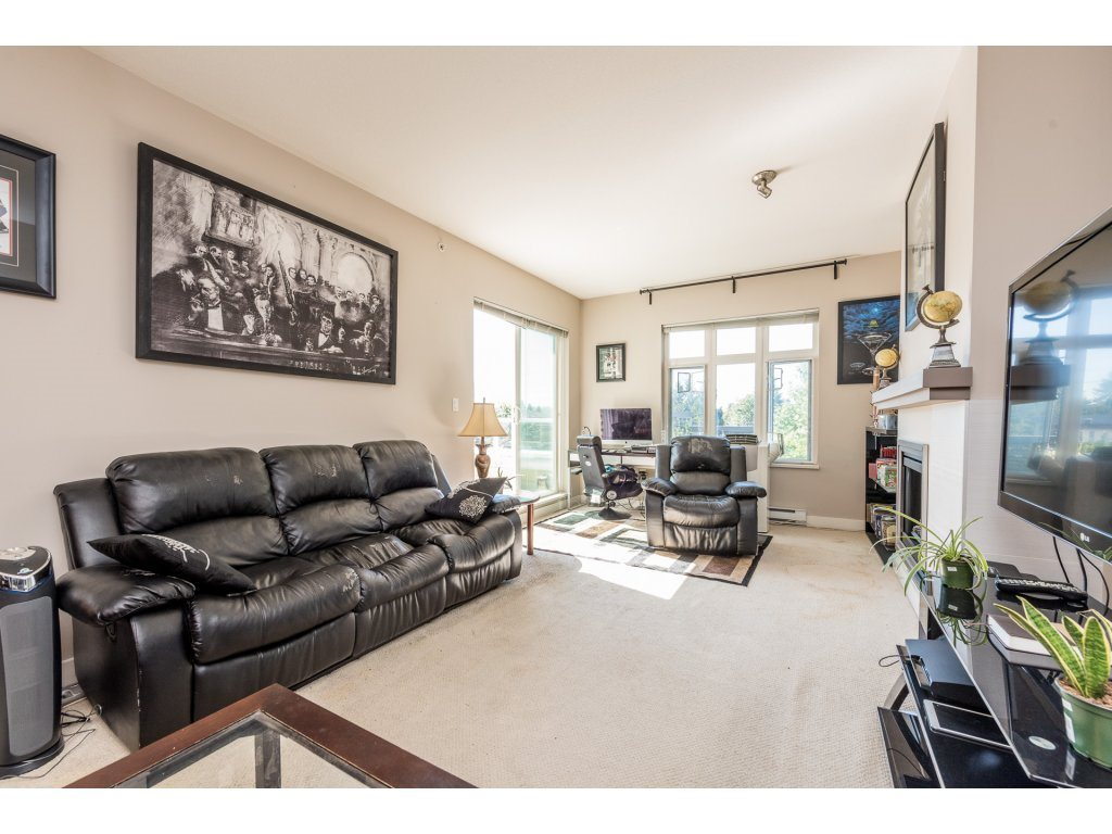 "Photo 4: 401 2368 MARPOLE Avenue in Port Coquitlam: Central Pt Coquitlam Condo for sale in ""RIVER ROCK LANDING"" : MLS® # R2201922"