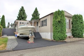 "Main Photo: 3 8254 134 Street in Surrey: Queen Mary Park Surrey Manufactured Home for sale in ""WESTWOOD ESTATES"" : MLS® # R2204022"