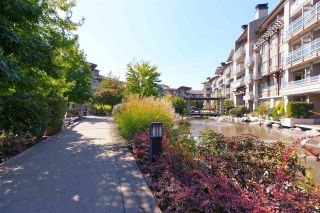 "Main Photo: 404 560 RAVEN WOODS Drive in North Vancouver: Roche Point Condo for sale in ""SEASONS WEST at Raven Woods"" : MLS®# R2303963"