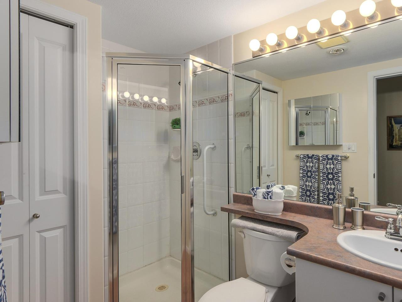 "Photo 5: 410 260 NEWPORT Drive in Port Moody: North Shore Pt Moody Condo for sale in ""THE MCNAIR"" : MLS(r) # R2130250"