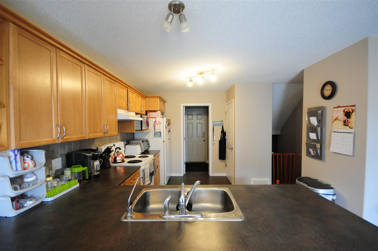 Very wide kitchen counter between dining room and kitchen