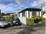 "Main Photo: 16 3031 200 Street in Langley: Brookswood Langley Manufactured Home for sale in ""Cedar Creek"" : MLS®# R2256615"