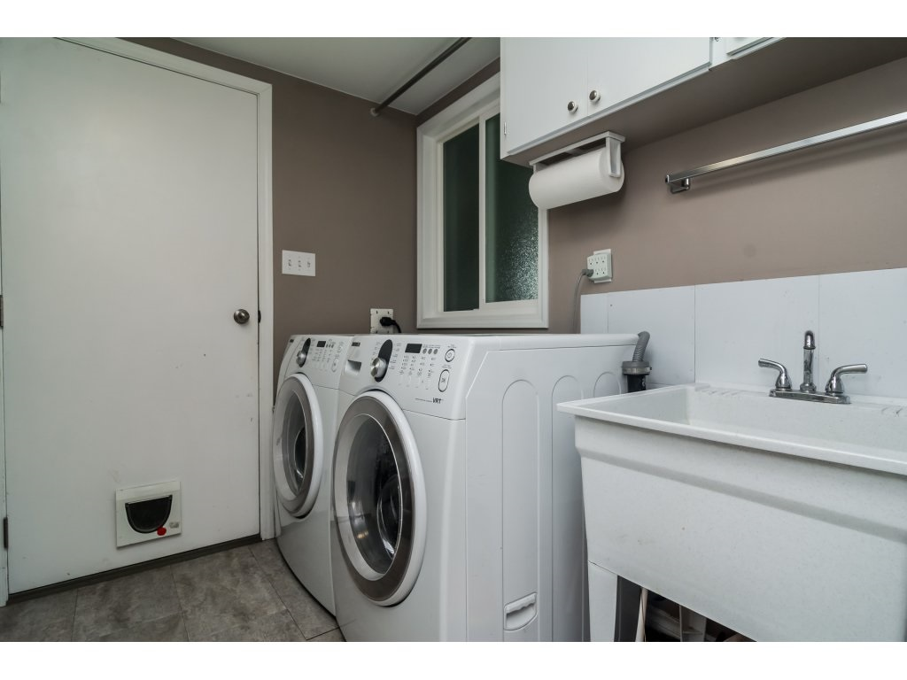 Laundry room off garage has great storage