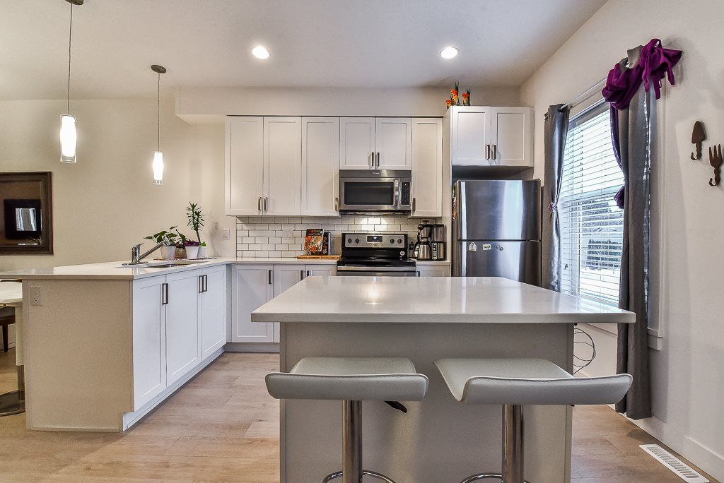 "Photo 7: Photos: 104 32789 BURTON Avenue in Mission: Mission BC Townhouse for sale in ""SILVER CREEK"" : MLS® # R2242269"