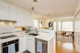 "Main Photo: 316 2565 W BROADWAY in Vancouver: Kitsilano Condo for sale in ""TRAFALGAR MEWS"" (Vancouver West)  : MLS®# R2312571"
