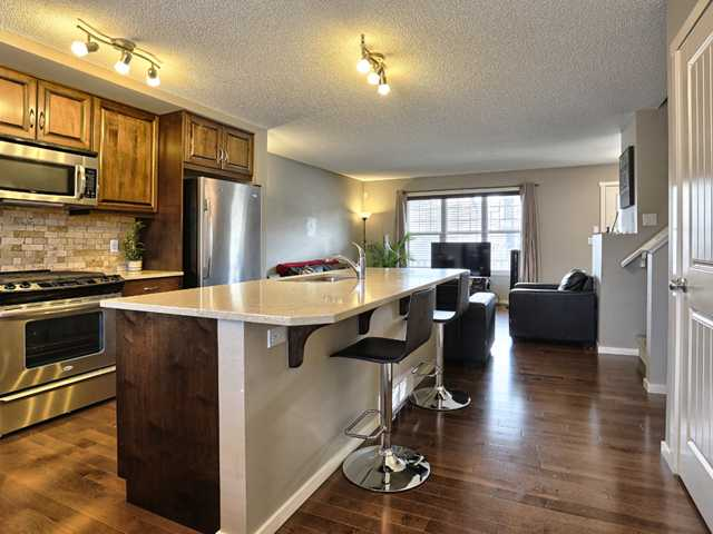 Large kitchen island, stainless steel appliances, GAS stove ....
