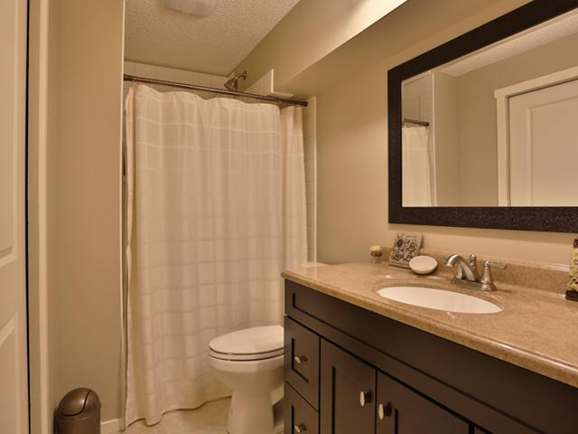 Basement bathroom with a large walk in shower ...