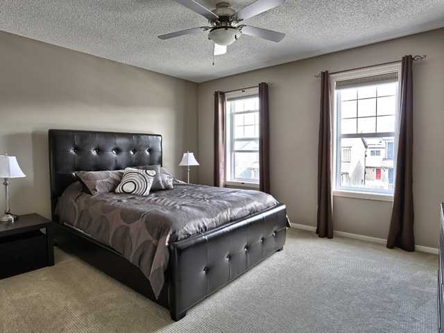 This bedroom is at the front of the home, with a large walk in closet and the 3 piece bath