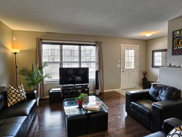 Large open concept living room, with hardwood flooring and lots of space for your furniture