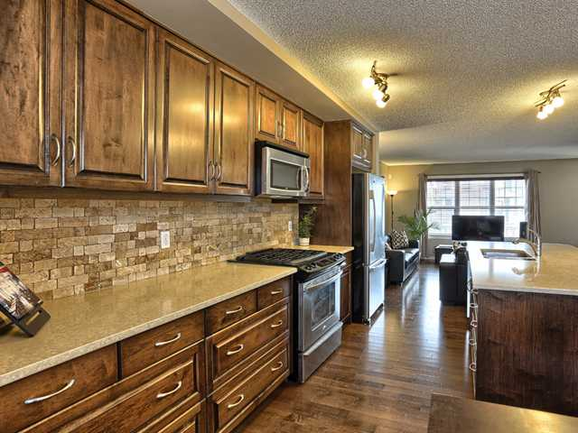 Extended countertops, beautiful tile, clean lines, lots of pan drawers....