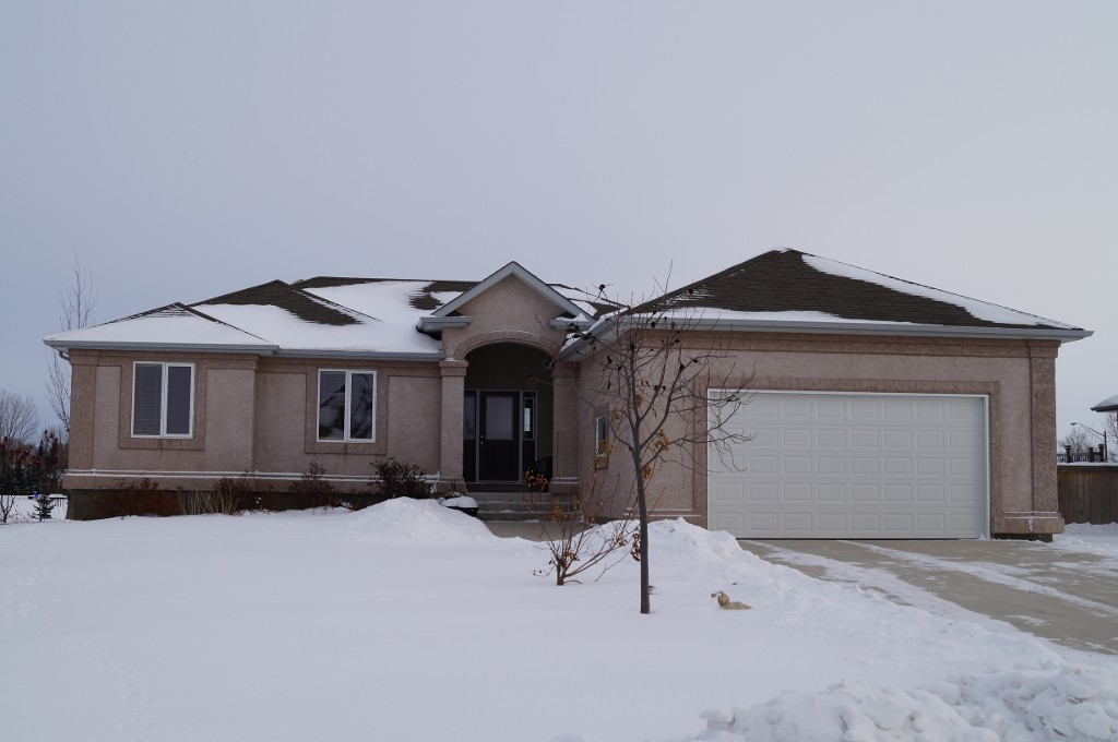 GREAT Family Home! Outstanding 1368sf 3+ Bedroom Bungalow built in 2005 with Fully Finished Basement, oversized 24 x 26 AT2, on Beautifully Landscaped 80x140 Lot with inground sprinklers, backing onto green space & park in the Town of Oakbank.