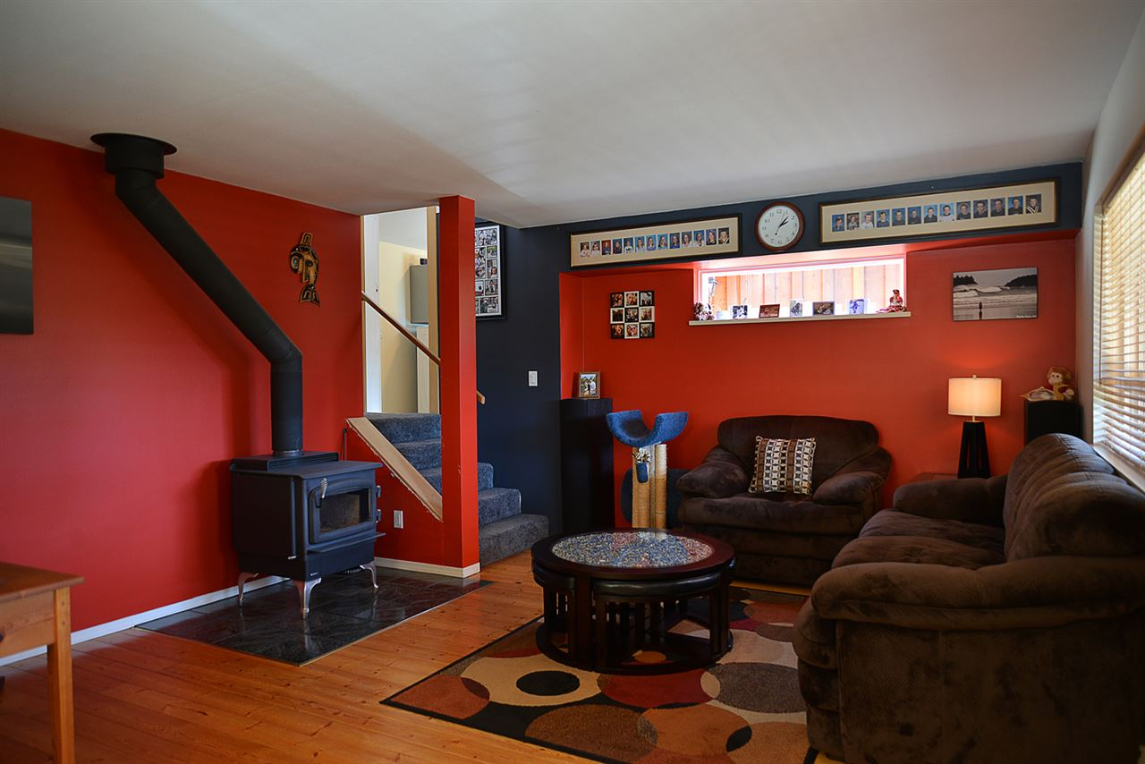 Main home living room with wood stove to warm this beautiful home.