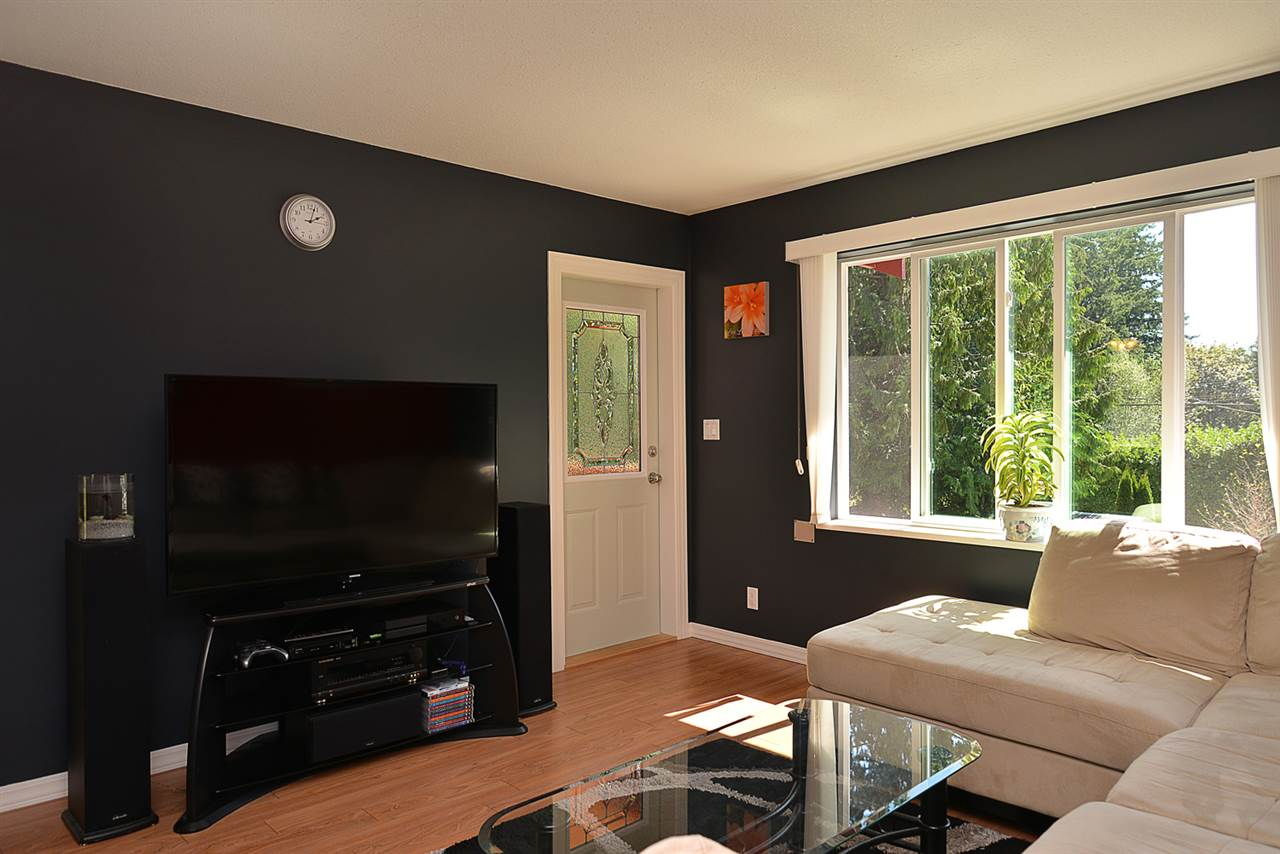 Secondary living space is bright and sunny; feature door to balcony.