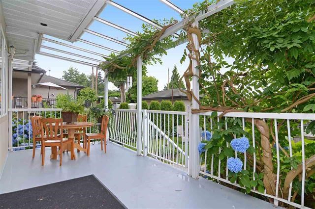 amazing gardening space with garage and carport with lane access.