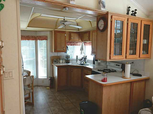 "Photo 1: 56 2170 PORT MELLON Highway in Gibsons: Gibsons & Area Manufactured Home for sale in ""Langdale Heights RV Park & Par 3 Golf Resort"" (Sunshine Coast)  : MLS(r) # V1134753"