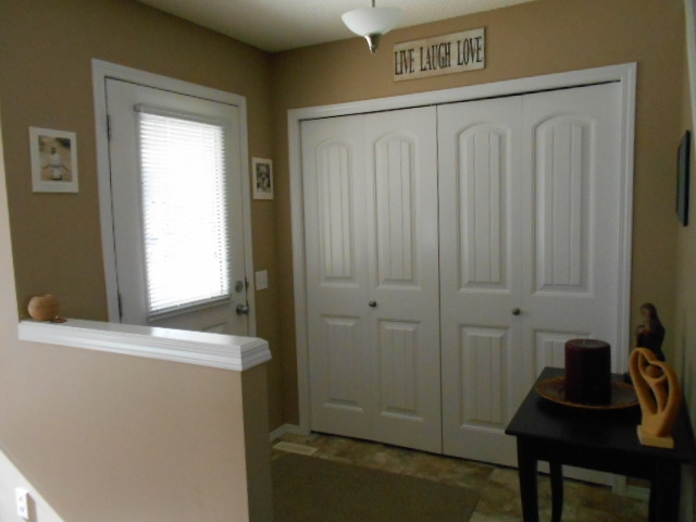 Spacious front foyer with double closets