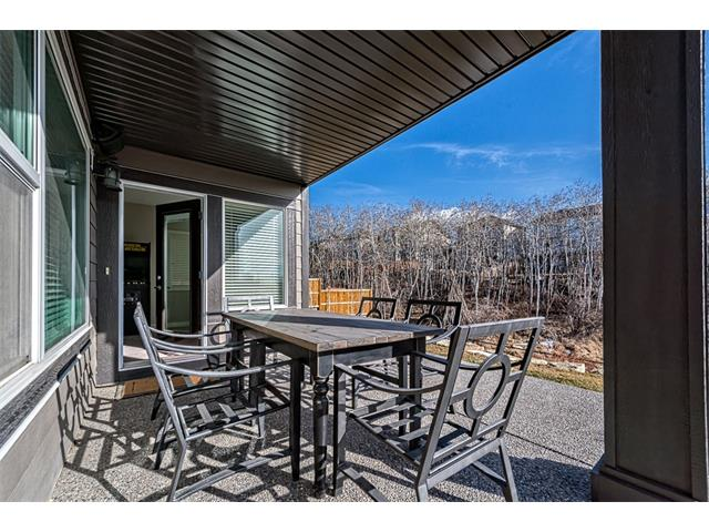 Patio overlooking private wooded area beyond.