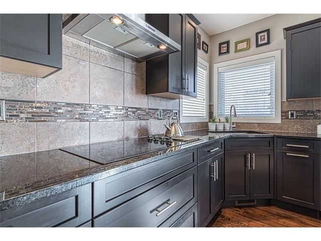 Tiled back splash and granite counters.