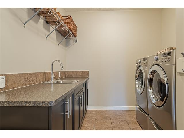 Laundry is conveniently located on the main floor and features built in cabinets and a sink.