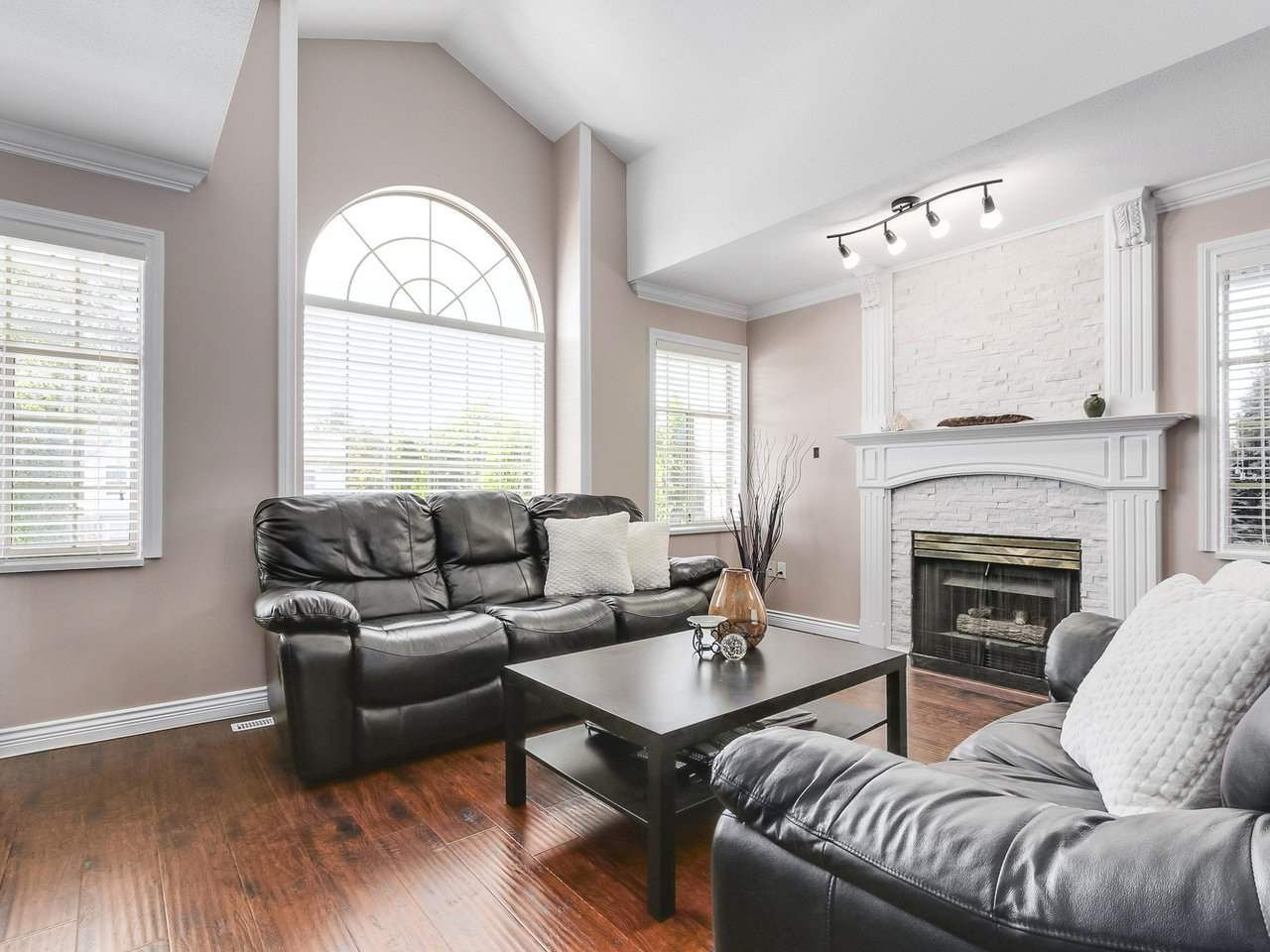 Upstairs living room is large and comes with cozy fireplace