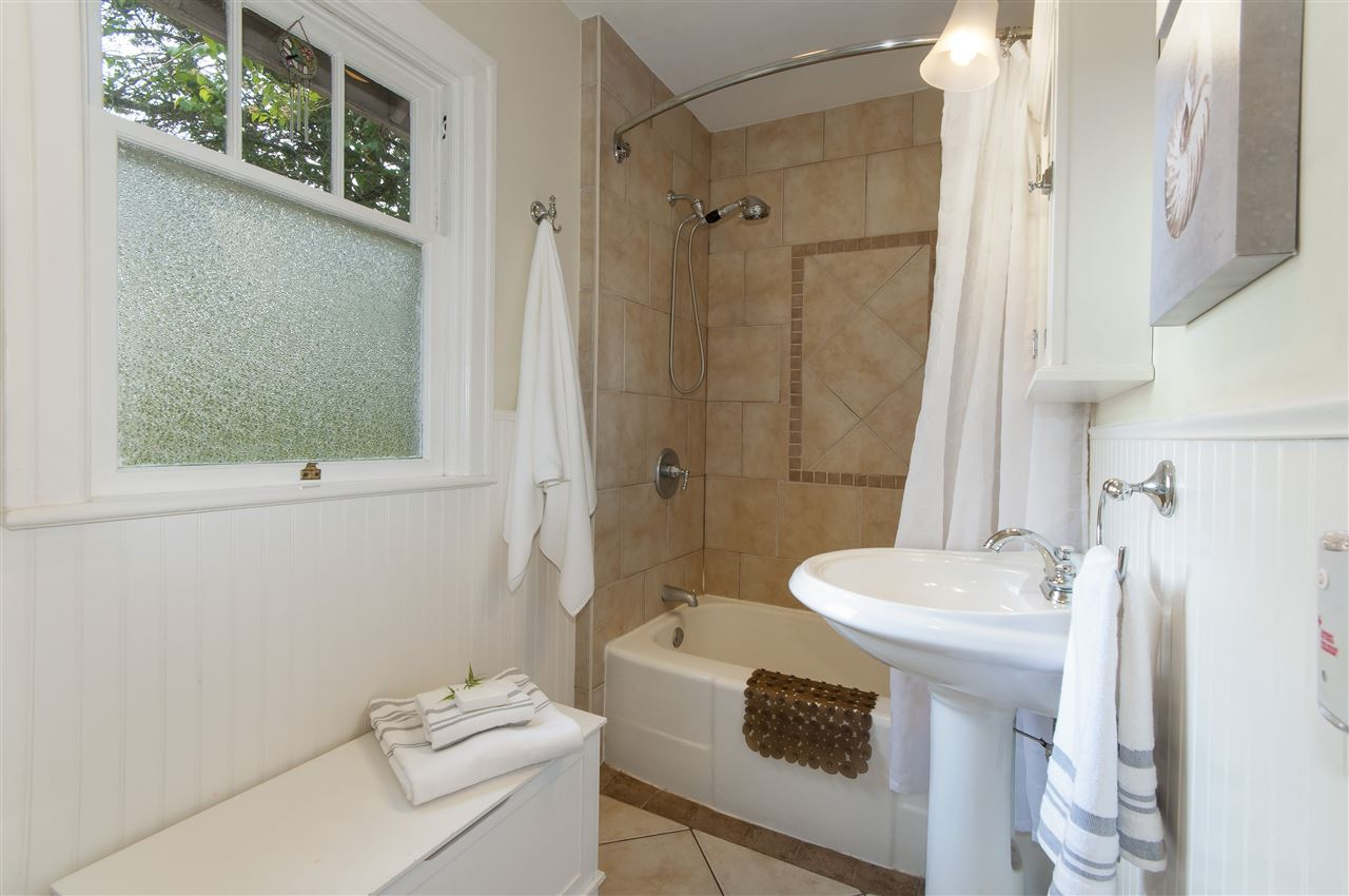 The bathroom on the main level was renovated in 2007 with in-floor radiant heating, deep soaker tub, pedestal sink, fan on a timer, matching toilet & multiple storage cabinets.