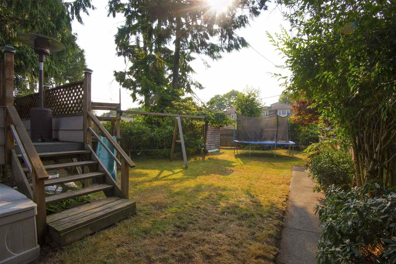 One of the features that the current owners fell in love with of this home was it's flat and sunny back yard! There is room not only for a playground set with swings but a trampoline!