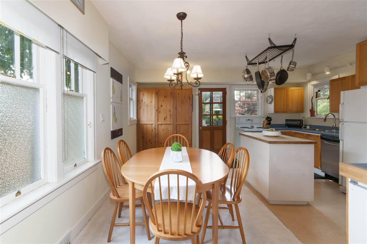 The dining room is easily accessible from the open kitchen and has the length to accommodate dining parties of 8 to 10 people.