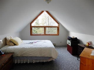 This could be the master bedroom of your dreams with its windows and length for cabinets.