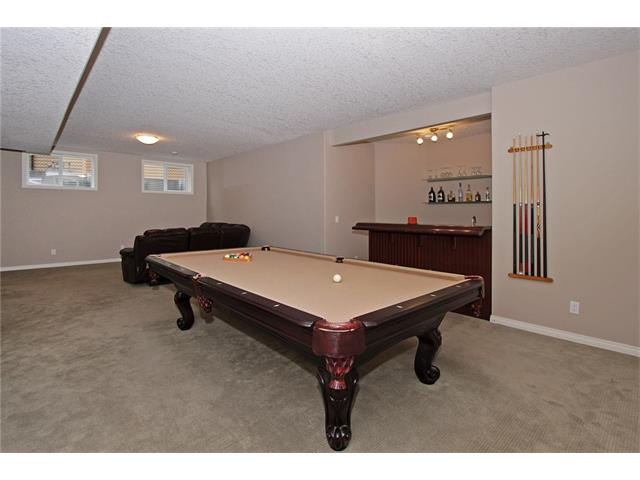 Basement rec room, pool table included. In floor heat, high ceilings, large windows