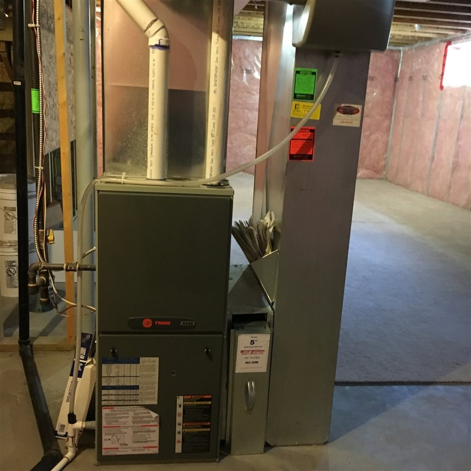 Photo Showing the Energy Efficient Furnace and a Portion of the Open Unfinished Lower Level Allowing You to Develop it to Suit Your Needs. It is Plumbed in for another Bathroom. Upgrades including an energy efficient Tankless Hot Water System.