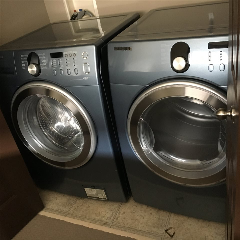 The Side by Side Samsung Front Load Washer and Dryer are Conveniently Located on the Upper Level Between the Master Bedroom and the 4 Piece Bathroom.