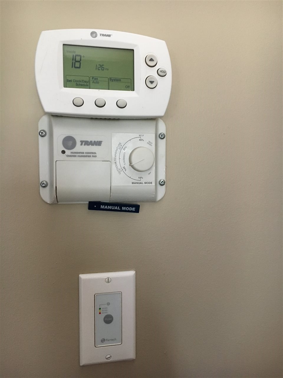Close up Photo of Programable Thermostats for the Upgraded Energy Efficient Trane Heating System.
