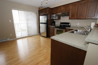 "Main Photo: 101 15175 62A Avenue in Surrey: Sullivan Station Townhouse for sale in ""Brooklands"" : MLS(r) # R2110179"