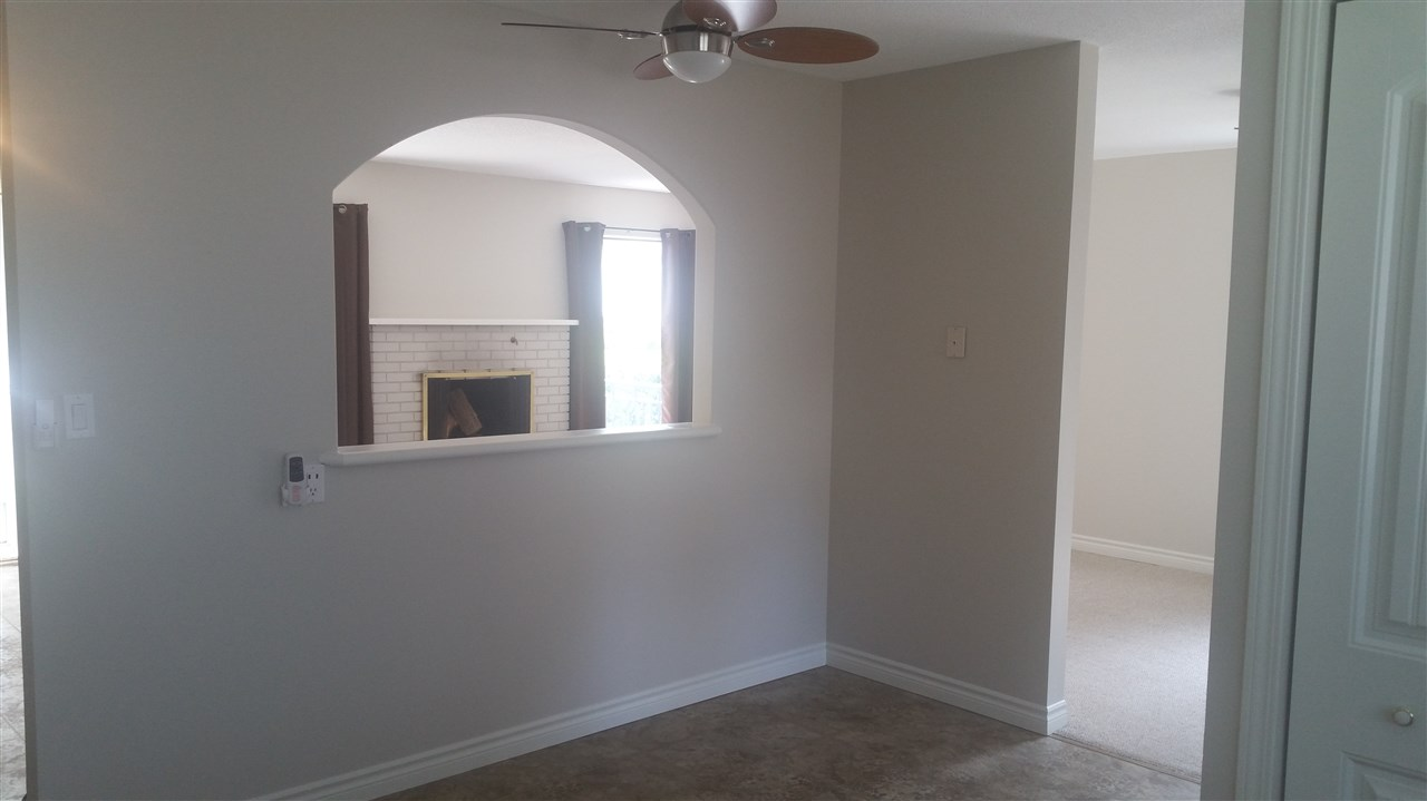 Picture window from living room to kitchen