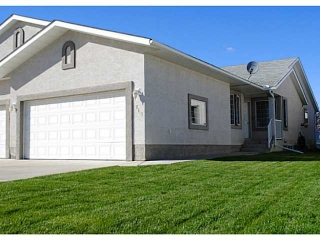 Main Photo: 110 RIVERSIDE Crescent NW: High River Residential Attached for sale : MLS® # C3586695