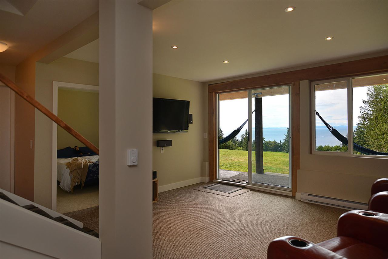 Open concept living area, totally renovated - barn doors lead to beautiful bathroom with slipper tub!