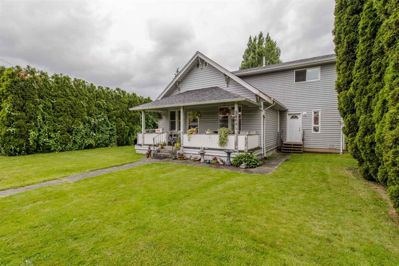 "Main Photo: 34631 1ST Avenue in Abbotsford: Poplar House for sale in ""HUNTINGDON VILLAGE"" : MLS(r) # R2080258"