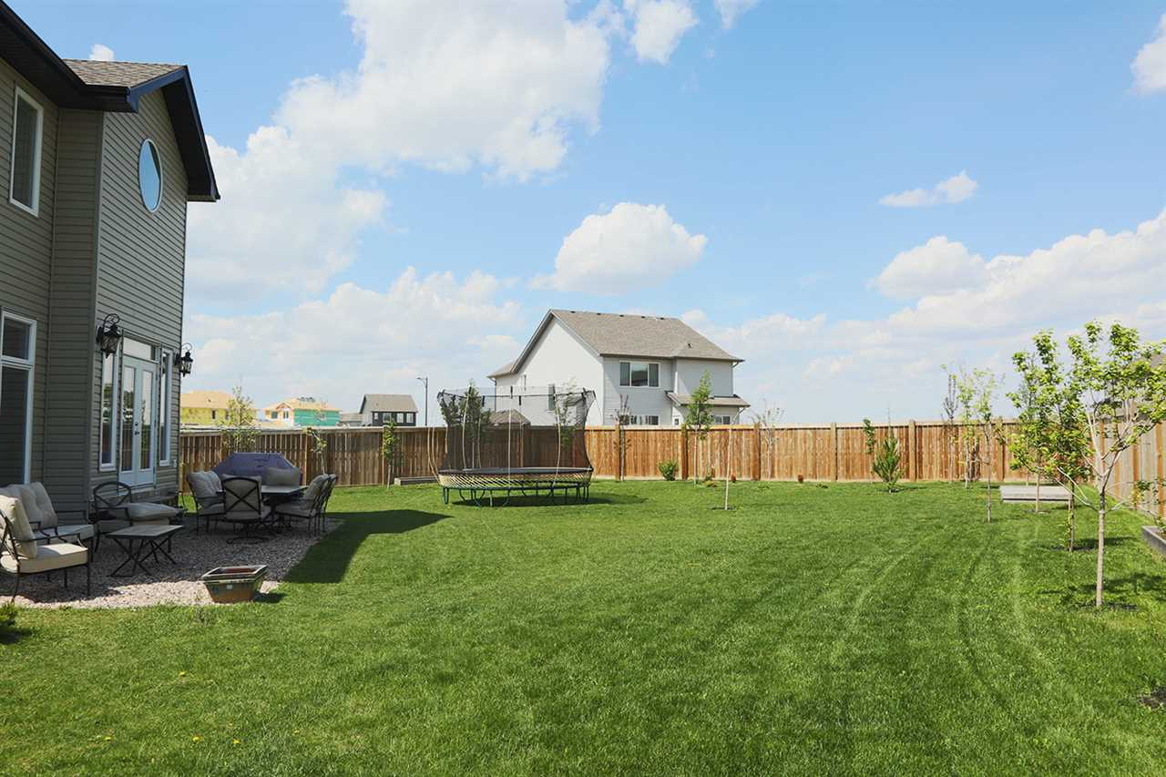 HUGE, Fully Landscaped, Fenced backyard with tons of room to entertain!