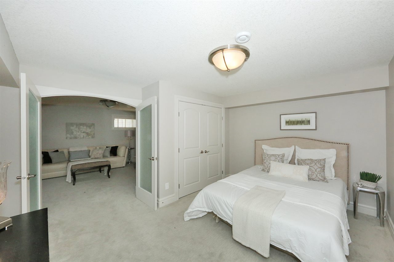 One of three good size bedrooms in the fully finished basement of this move-in ready home.