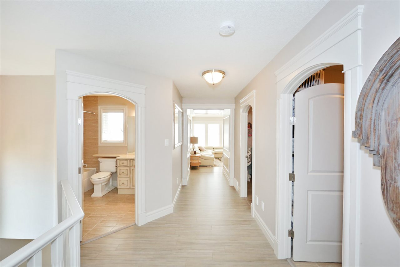View from the landing of the bright hallway that leads to Main 4-PC Bath, Large Laundry room with plenty of room for folding & storage, 2 bedrooms plus a luxurious spa-like master with 5-PC en-suite.